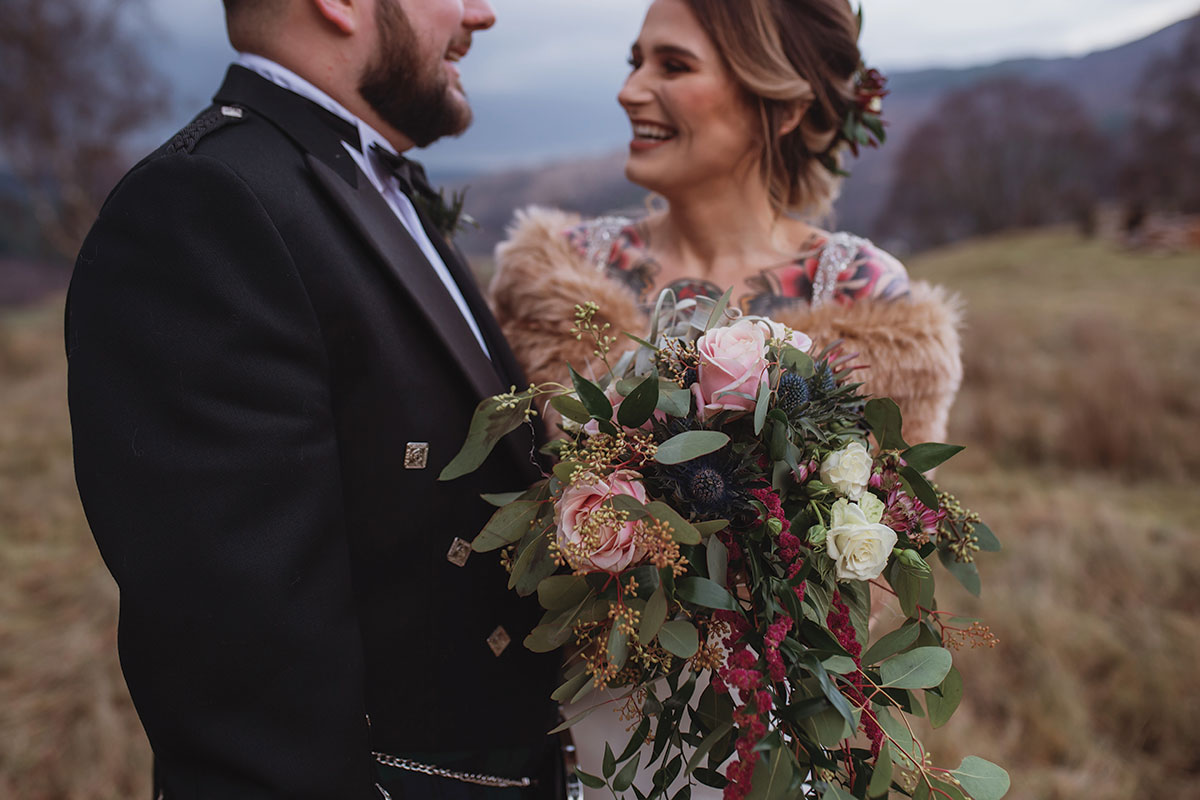 groom-and-bride-with-tattoos-and-rustic-wedding-flowers