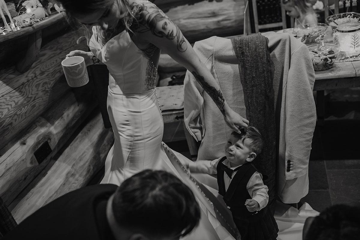 page-boy-holding-brides-dress