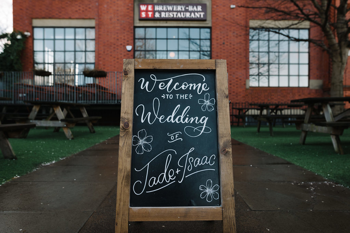 painted-wedding-sign-at-west-brewery