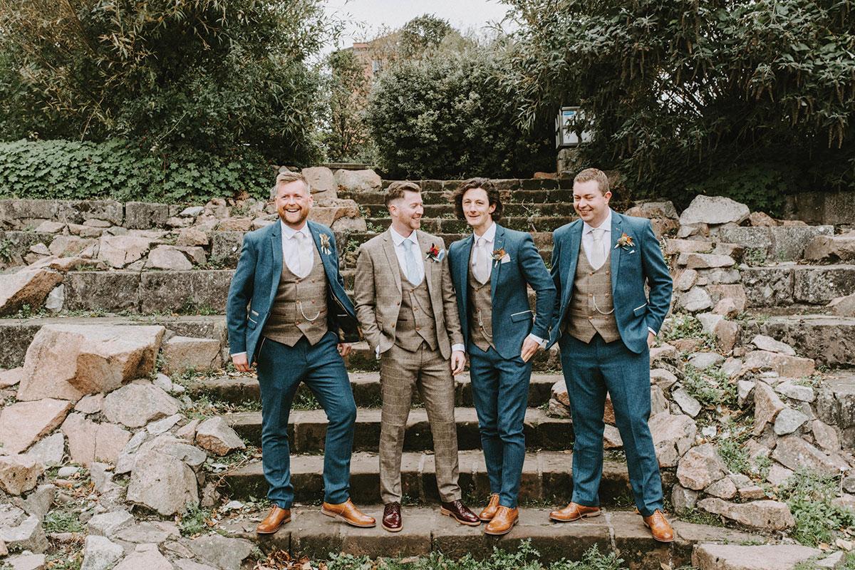 groom-in-tweed-suit-with-groomsmen-in-blue-tweed-suits