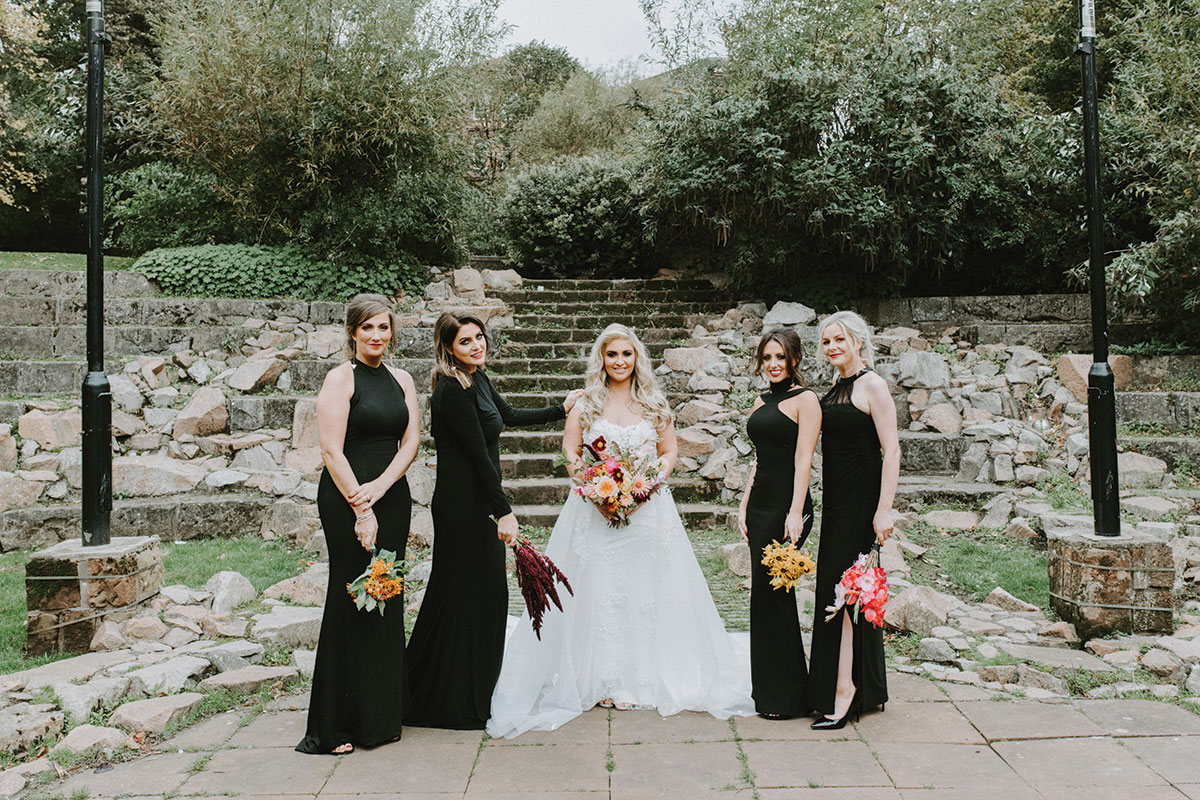bride-and-bridesmaids-in-black-dresses