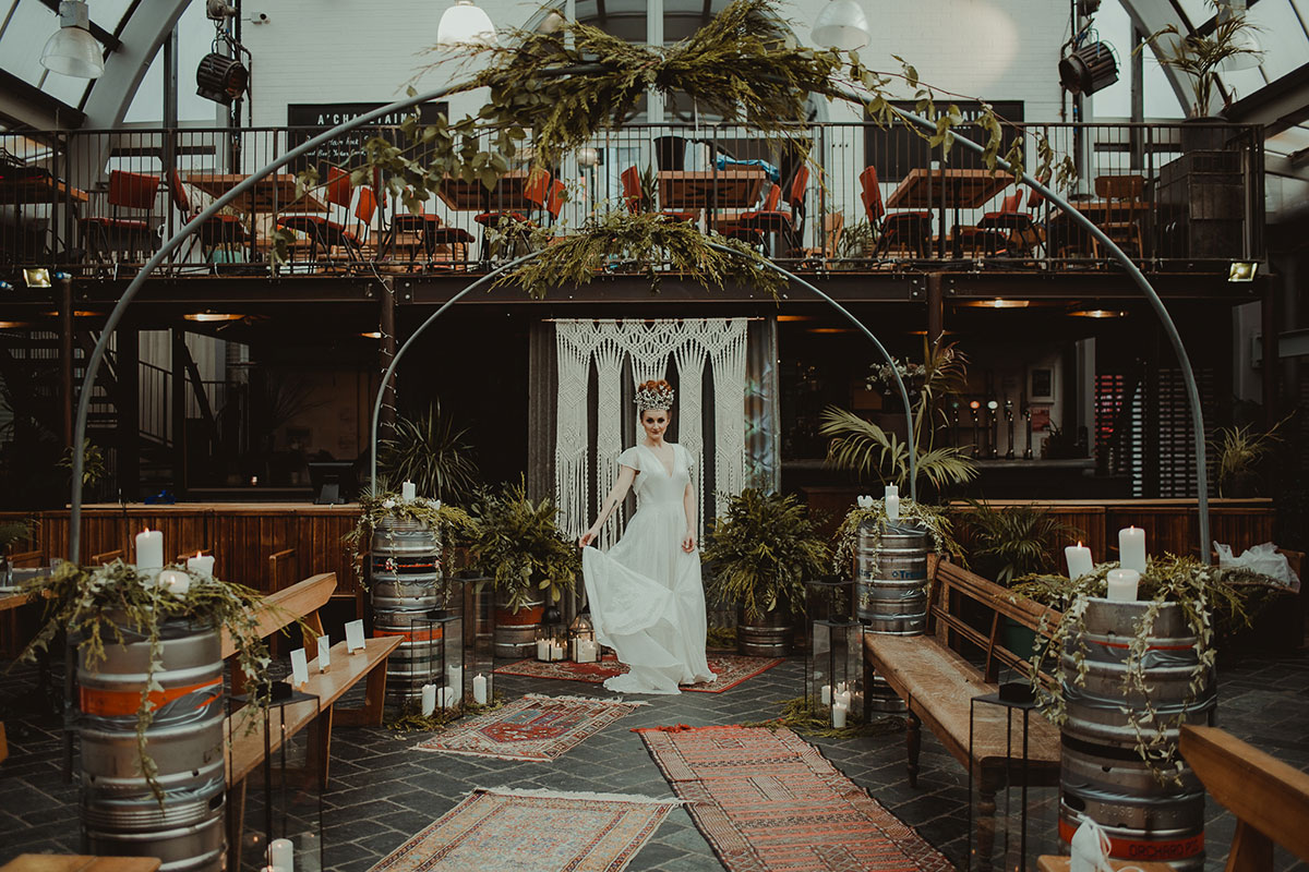 bride-under-foliage-arches-and-boho-styling