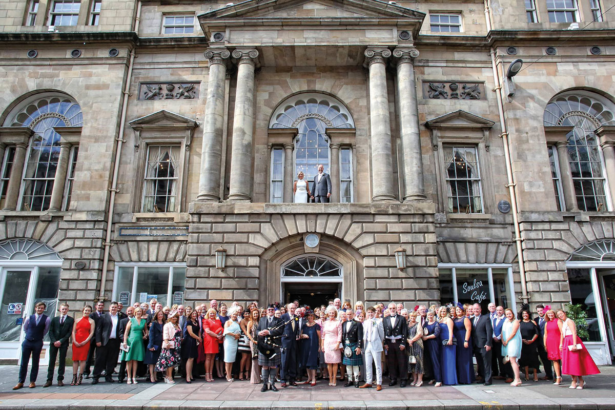 Wedding party outside Trades Hall, Glasgow