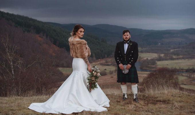 bride-with-fur-wrap-and-groom-wearing-kilt