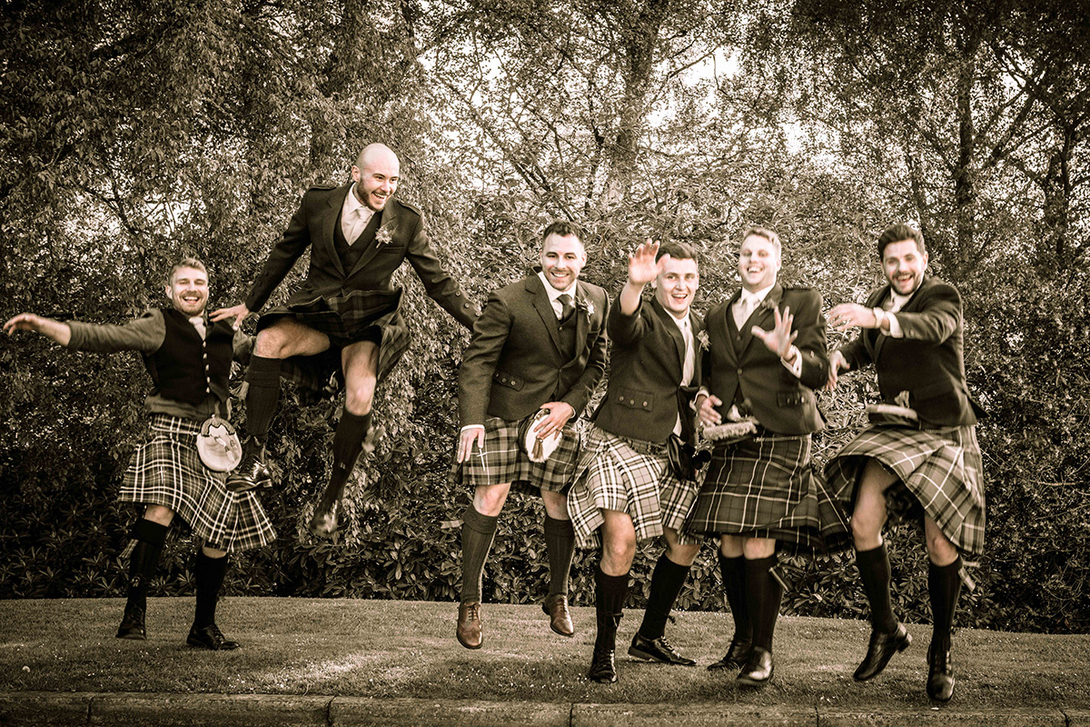 bridal-party-posing-in-grounds-of-crieff-hydro