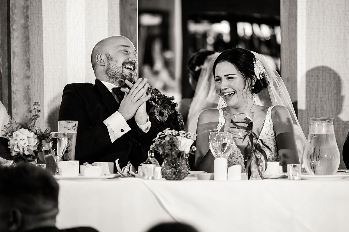 bride-and-groom-during-speeches