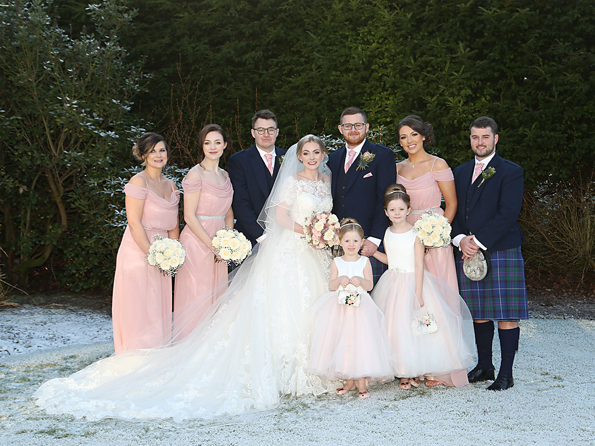 bridal-party-in-blue-kilt-outfits-and-pink-dresses