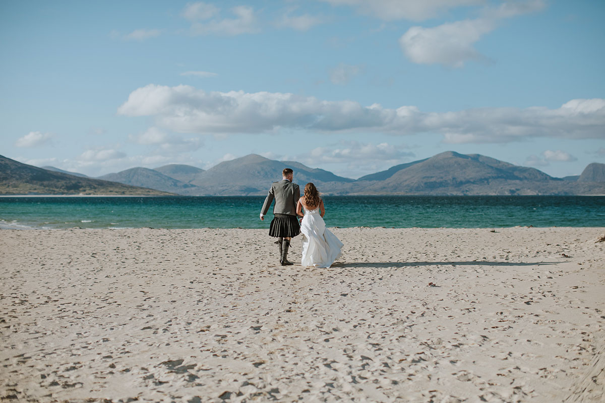 bride-and-groom-on-beach-at-harris