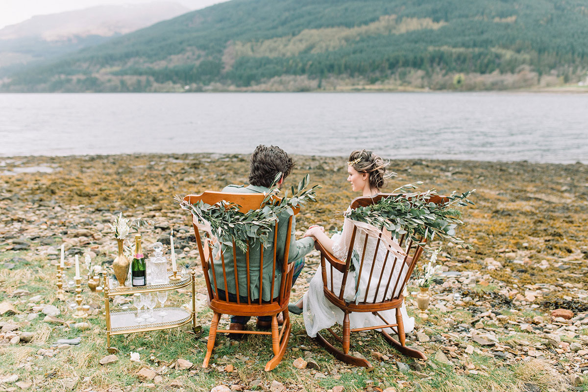 bride-and-groom-on-rocking-chairs-on-the-shore