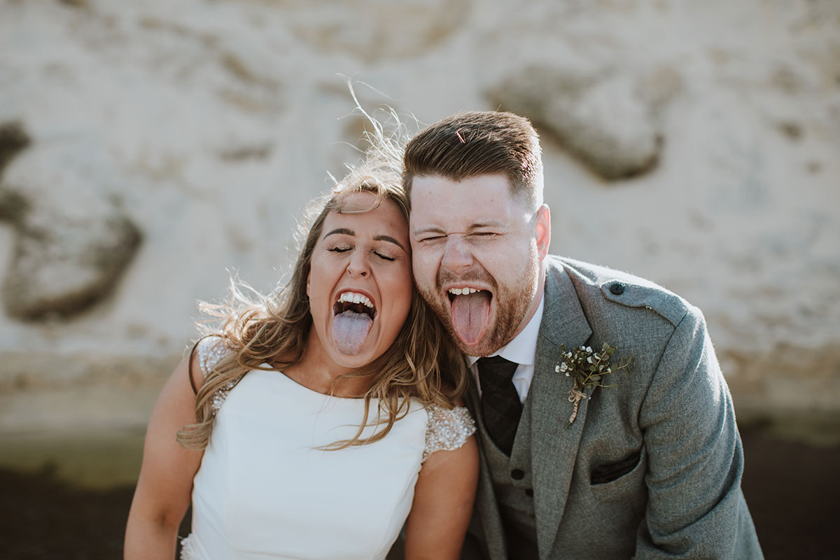 bride-and-groom-sticking-their-tongues-out