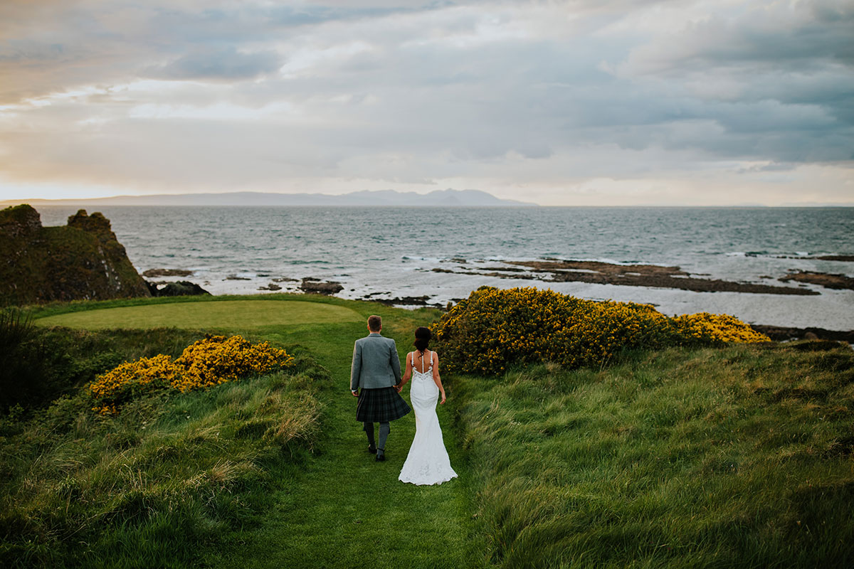 bride-and-groom-walking-along-ayrshire-coast