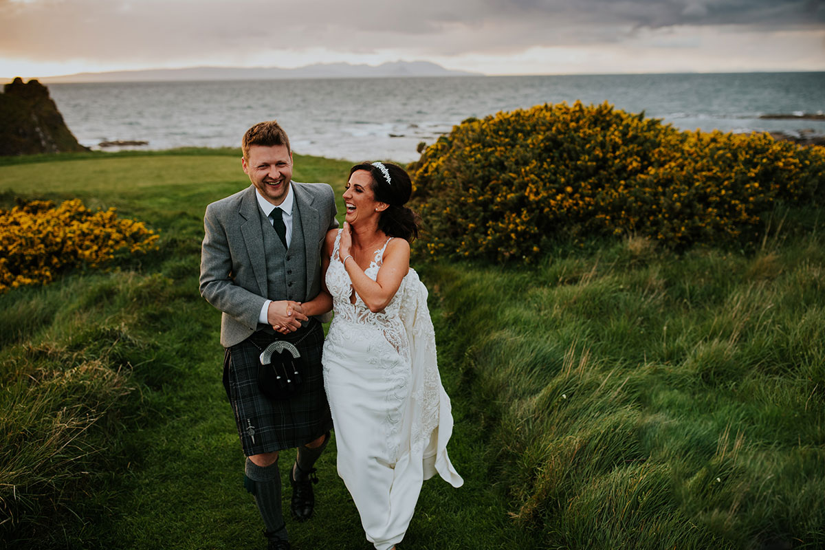 bride-and-groom-walking-back-from-turnberry-lighthouse