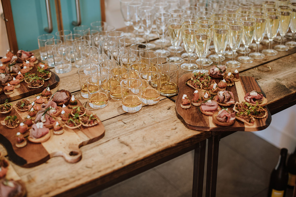 glasses-of-bubbles-and-boards-with-canapes