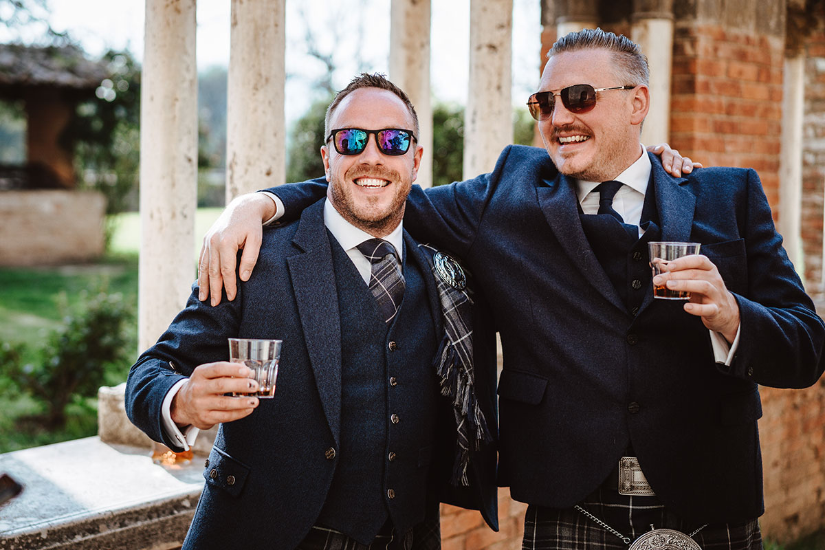 groom-and-groomsmen-in-blue-kilt-outfits