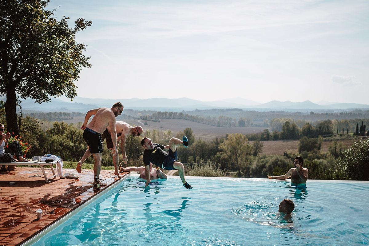groom-and-groomsmen-jumping-in-pool