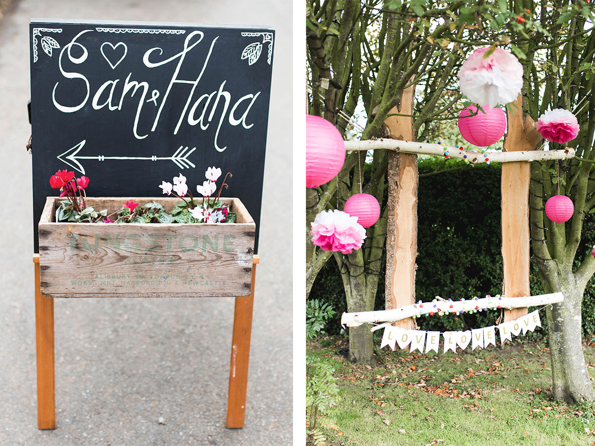 wedding-chalkboard-and-pom-pom-decoration-hung-on-trees
