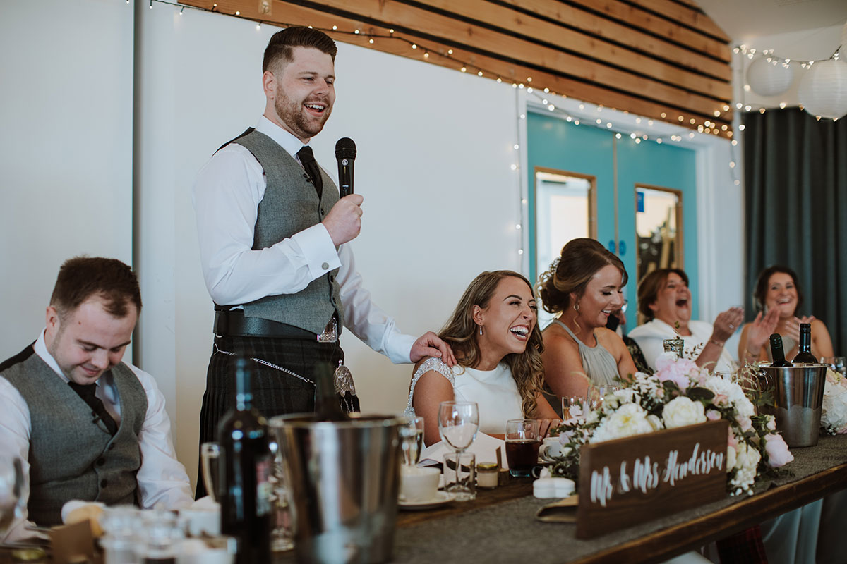 bride-laughing-as-groom-gives-speech