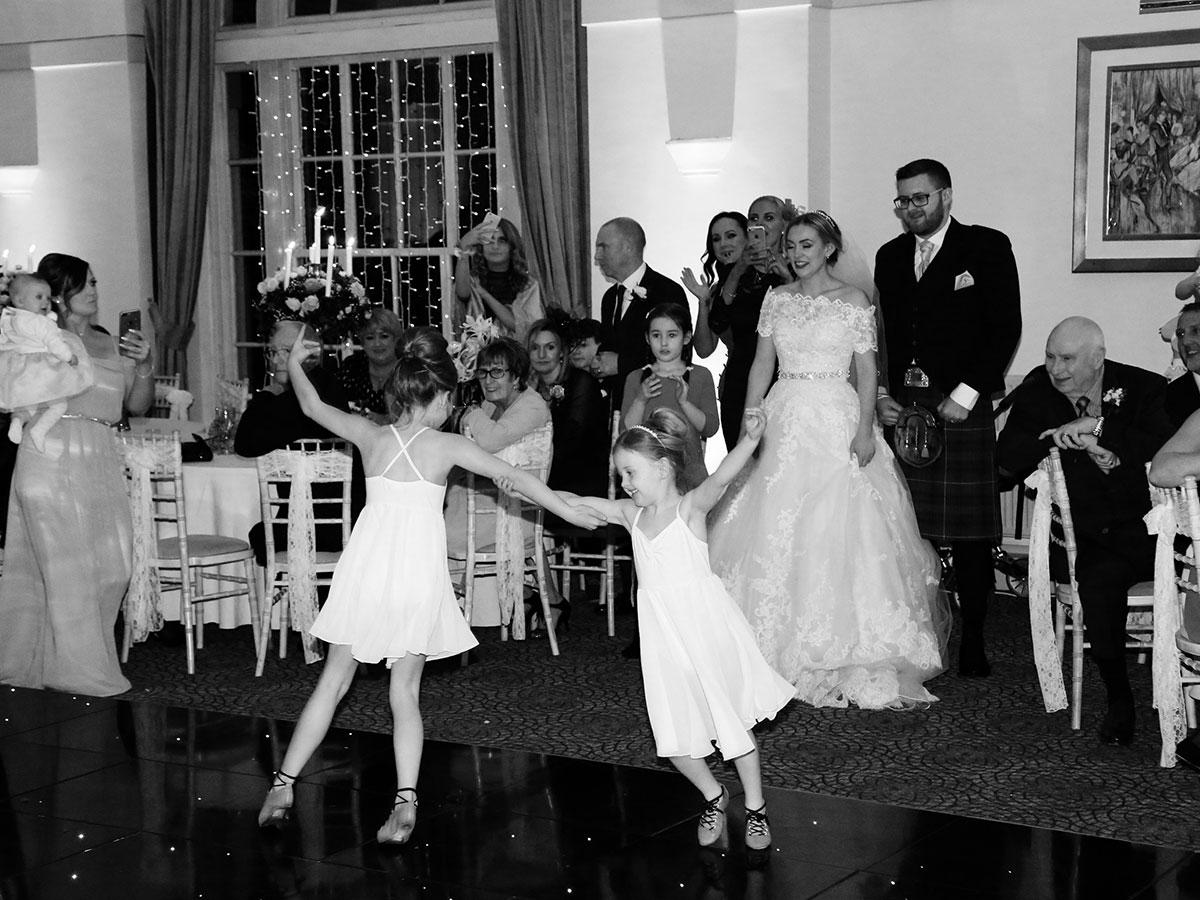 flowergirls-dancing-at-wedding