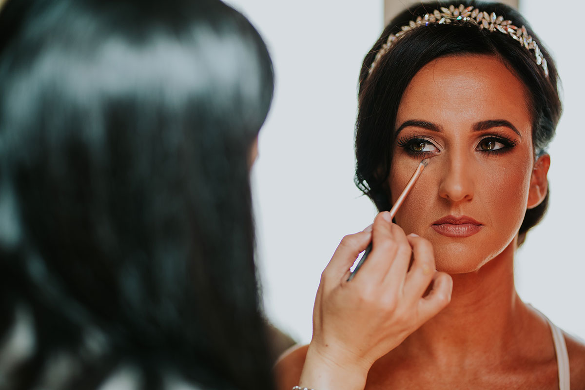bride-having-makeup-done