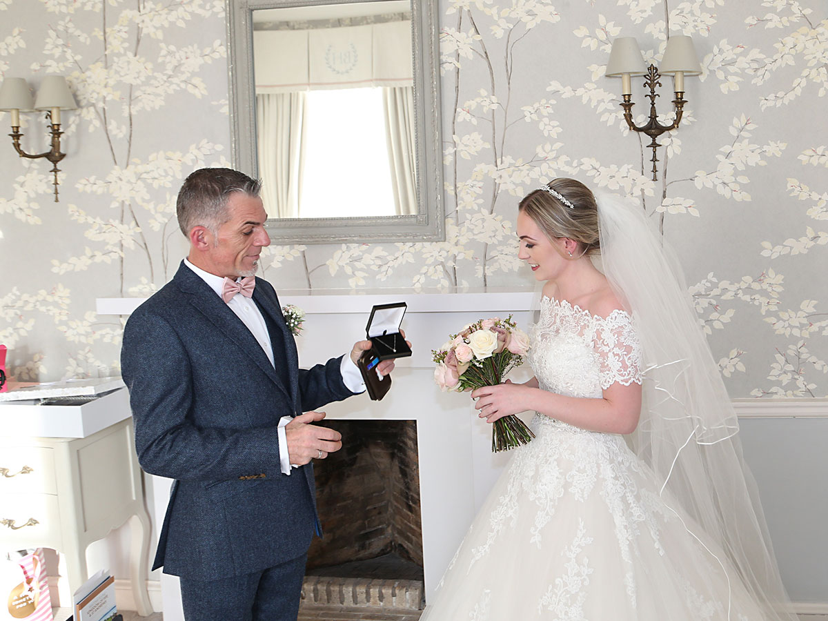 brides-father-presenting-her-with-a-gift
