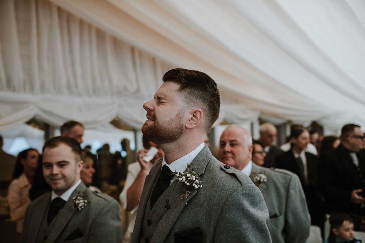 groom-looking-emotional-during-ceremony