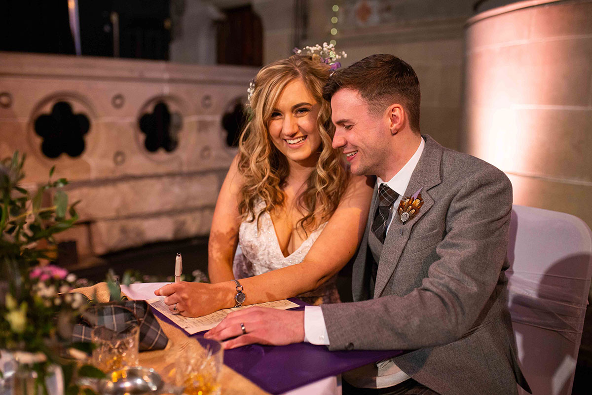 bride-and-groom-signing-the-register