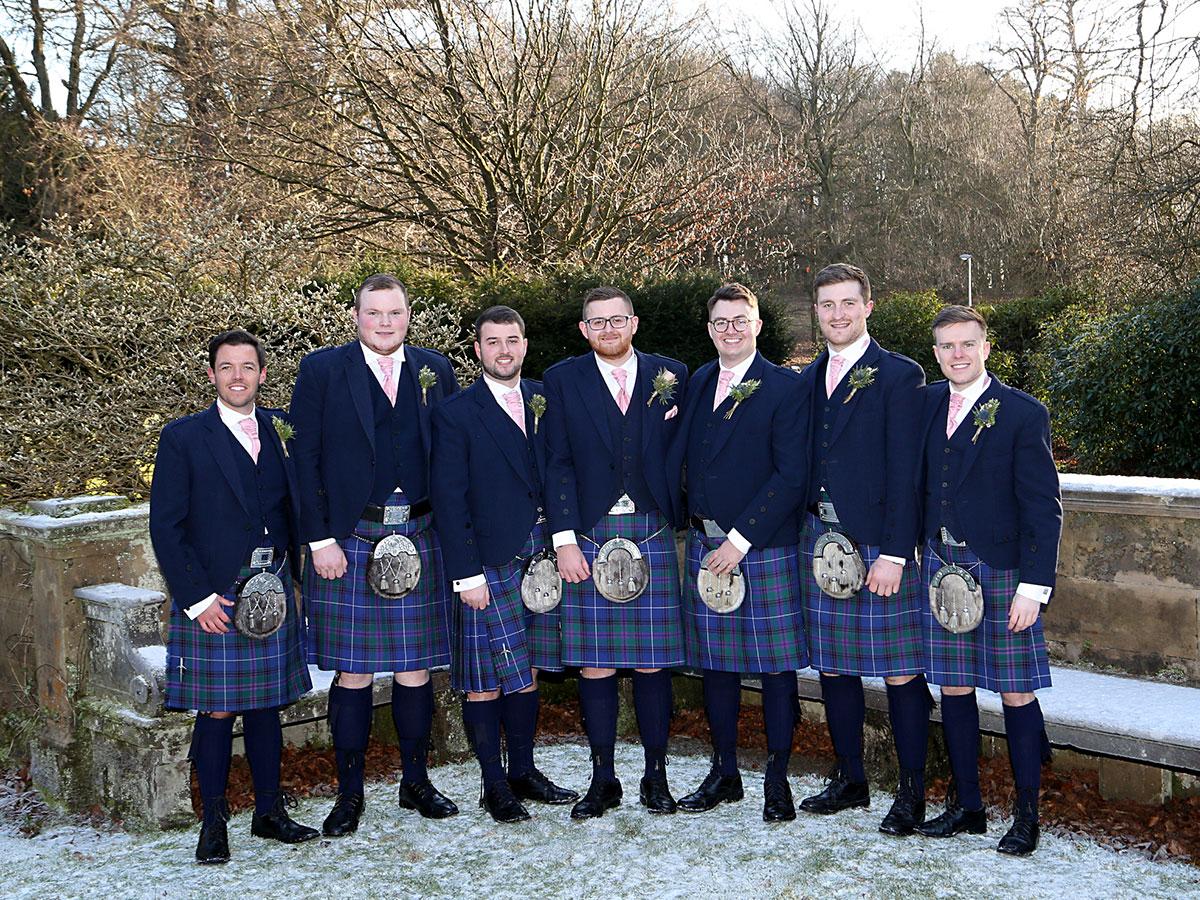 groom-and-groomsmen-in-blue-tweed-kilt-outfits