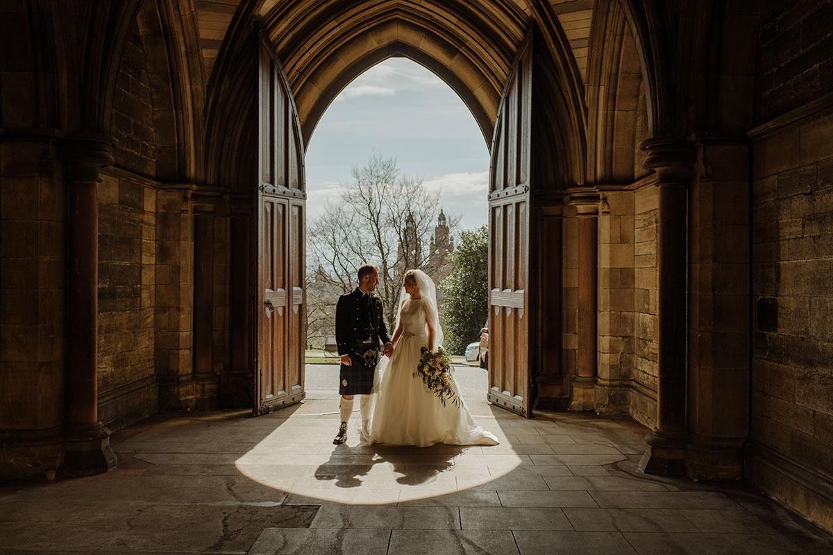 bride-and-groom-in-doorway-of-glasgow-cloisters