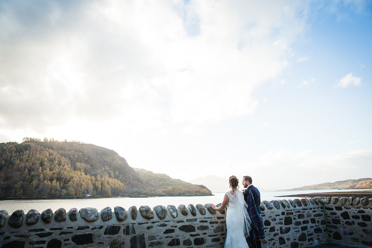 bride-and-groom-looking-out-over-loch