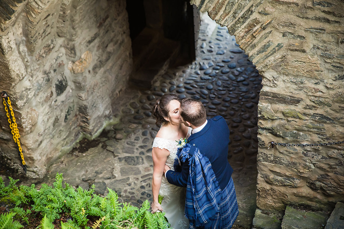 bride-and-groom-kissing-down-stone-steps