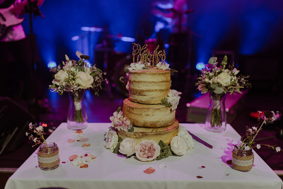 naked-wedding-cake-with-glittery-cake-topper