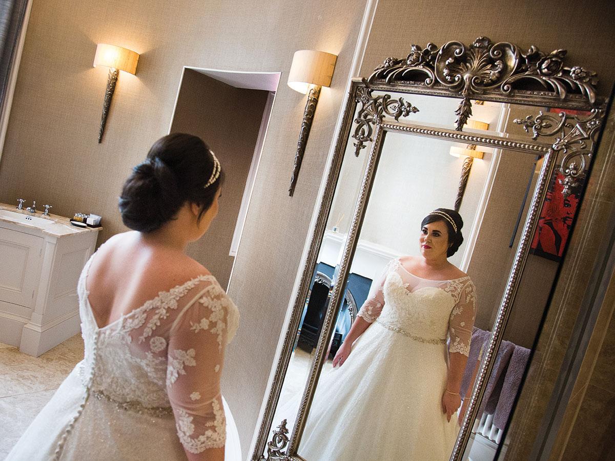 bride-looking-in-mirror-before-ceremony