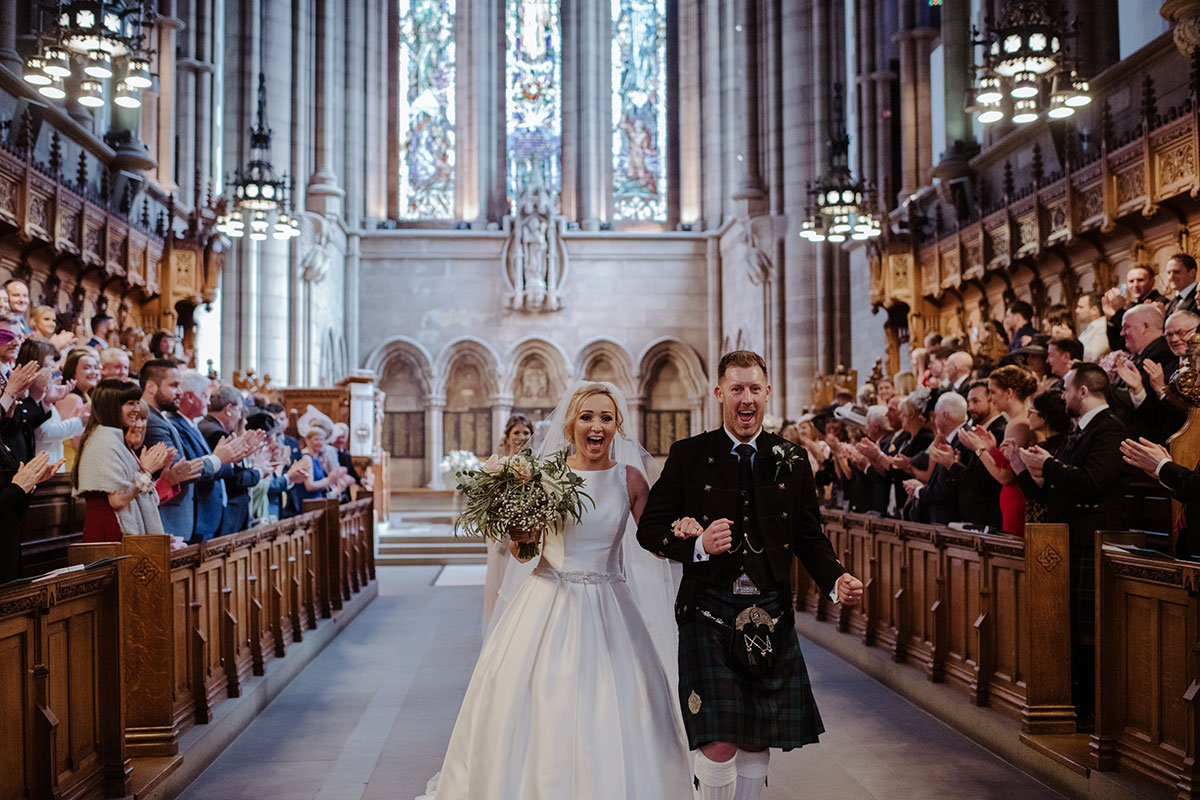 bride-and-groom-walking-down-aisle-after-ceremony