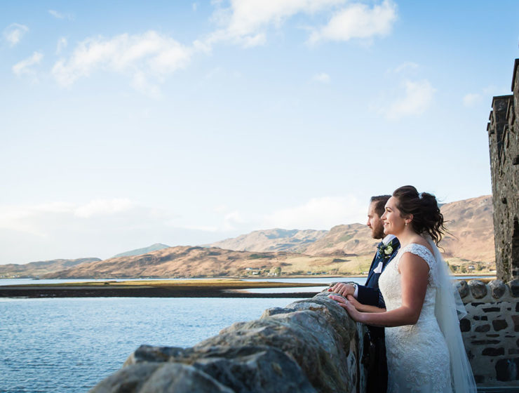 bride-and-groom-looking-out-over-water
