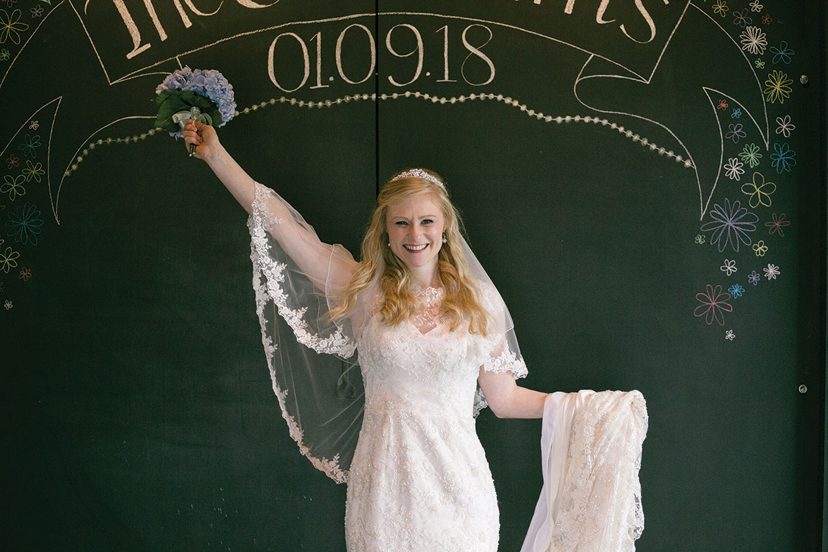 bride-in-front-of-chalk-board-display