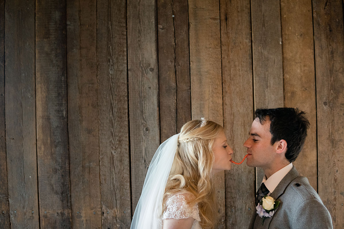 bride-and-groom-against-wooden-backdrop