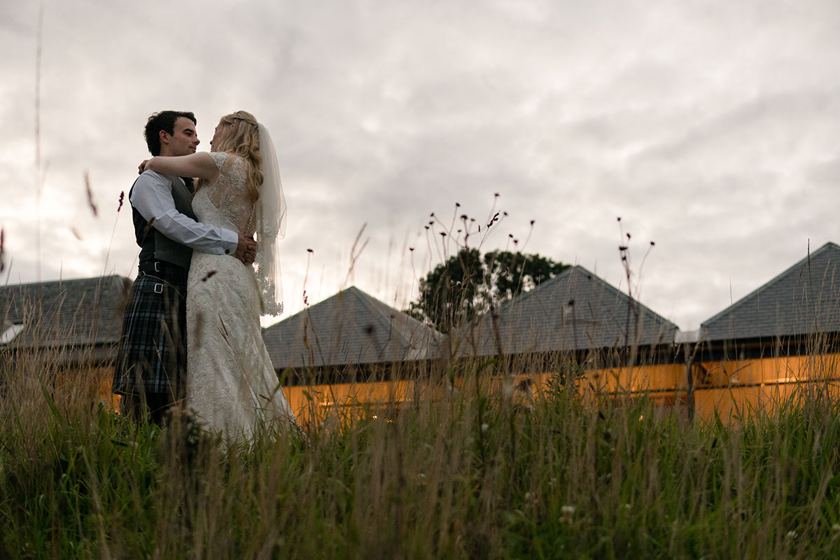 bride-and-groom-outside-guardswell-farm