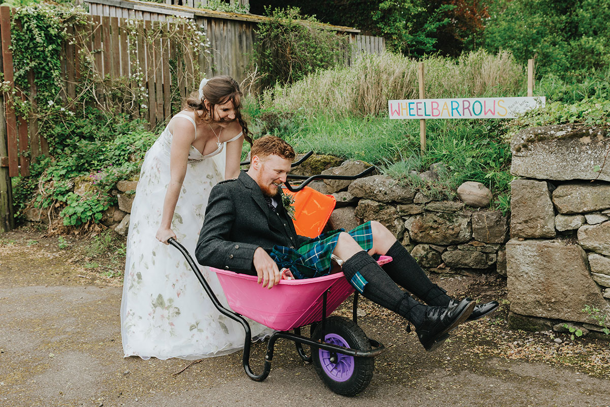 bride-pushing-groom-in-wheelbarrow