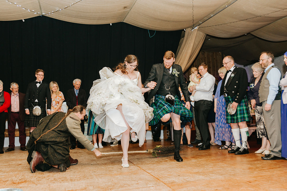 bride-and-groom-jumping-the-broom