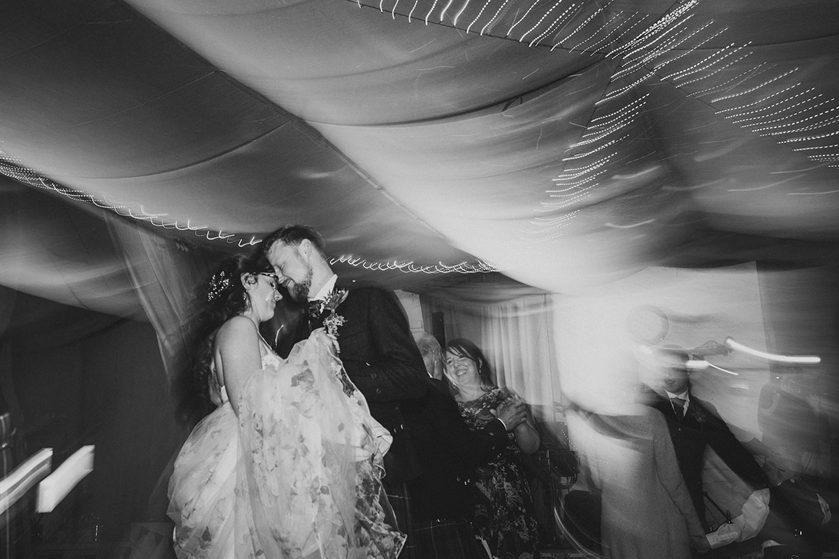 black-and-white-long-exposure-photo-of-bride-and-groom