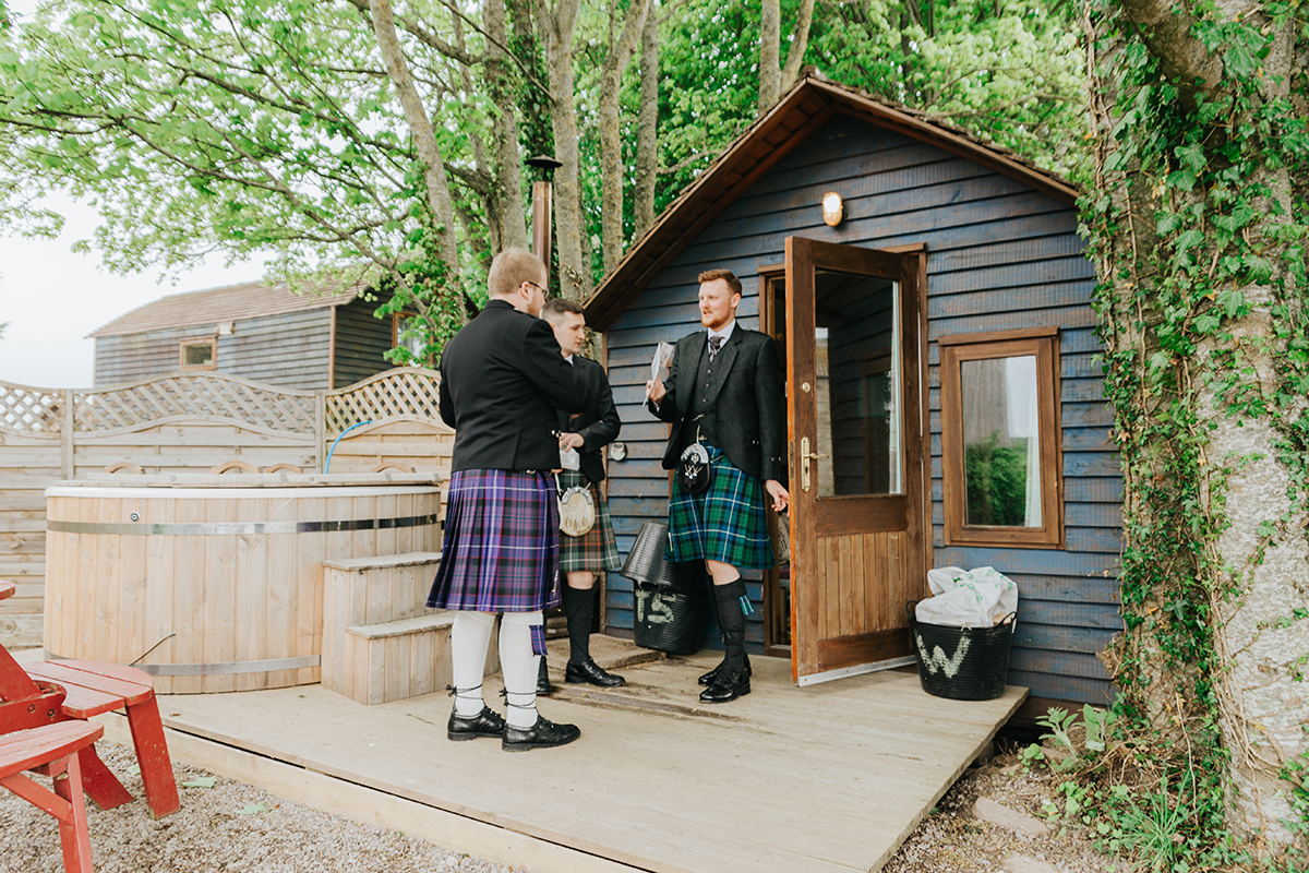 groom-and-groomsmen-in-wooden-lodge