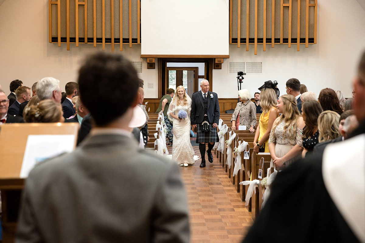 bride-walking-down-the-aisle-with-her-dad