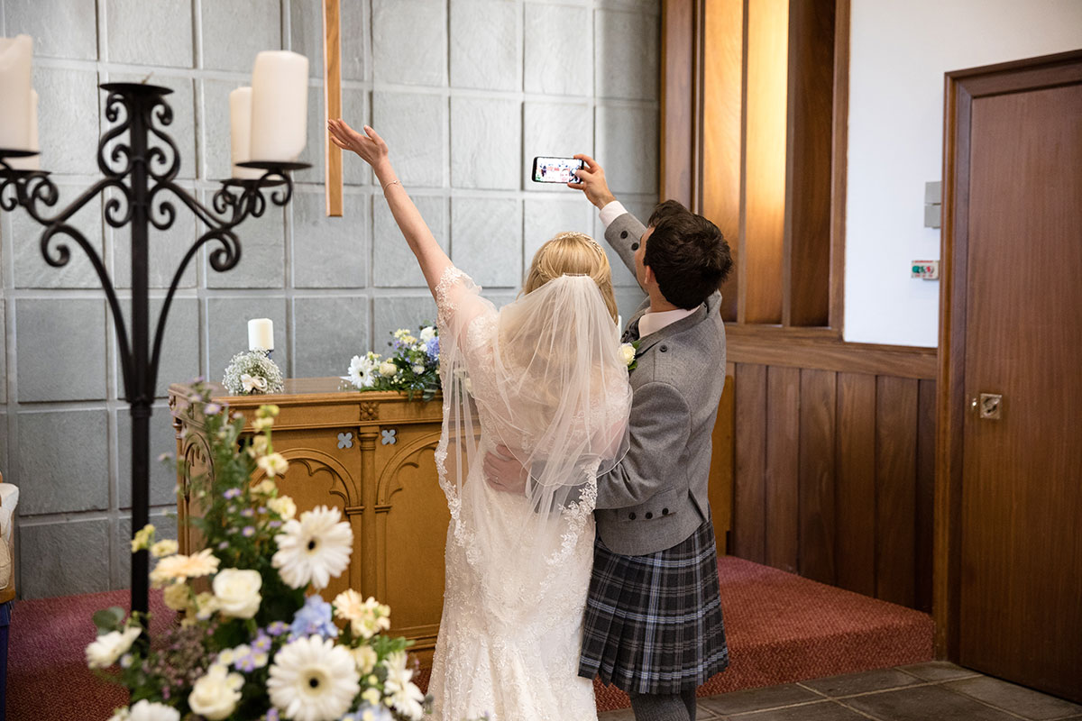 bride-and-groom-taking-selfie-after-ceremony