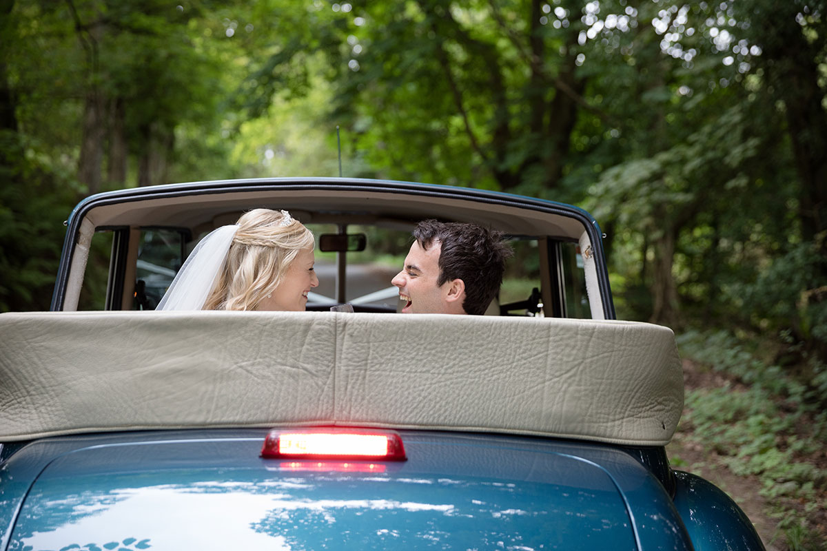 bride-and-groom-in-vintage-car