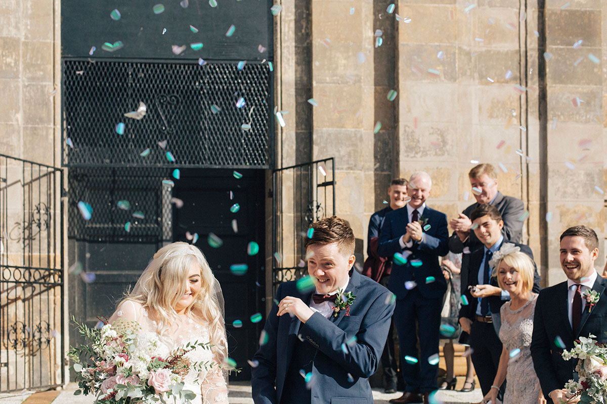 bride-and-groom-outside-saint-lukes-in-glasgow