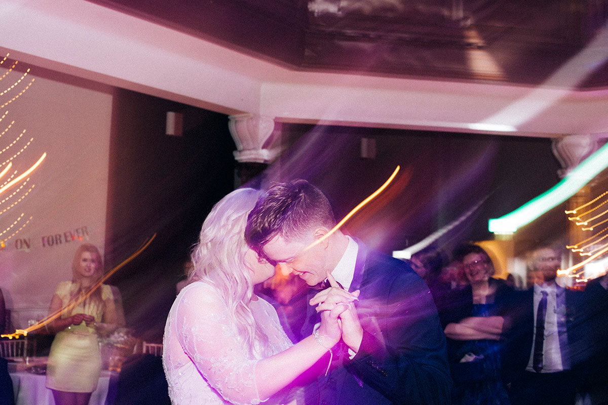 slow-exposure-shot-of-bride-and-groom-dancing