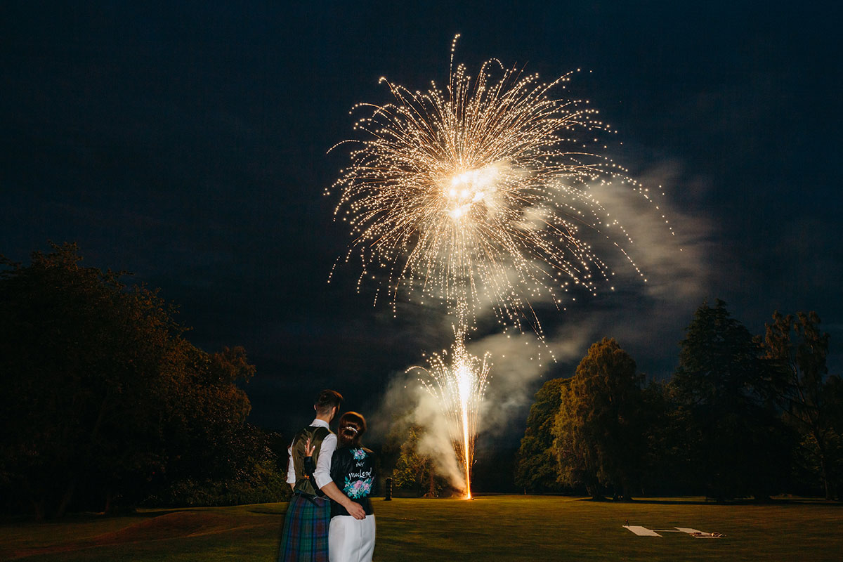 bride-and-groom-watching-firework-display