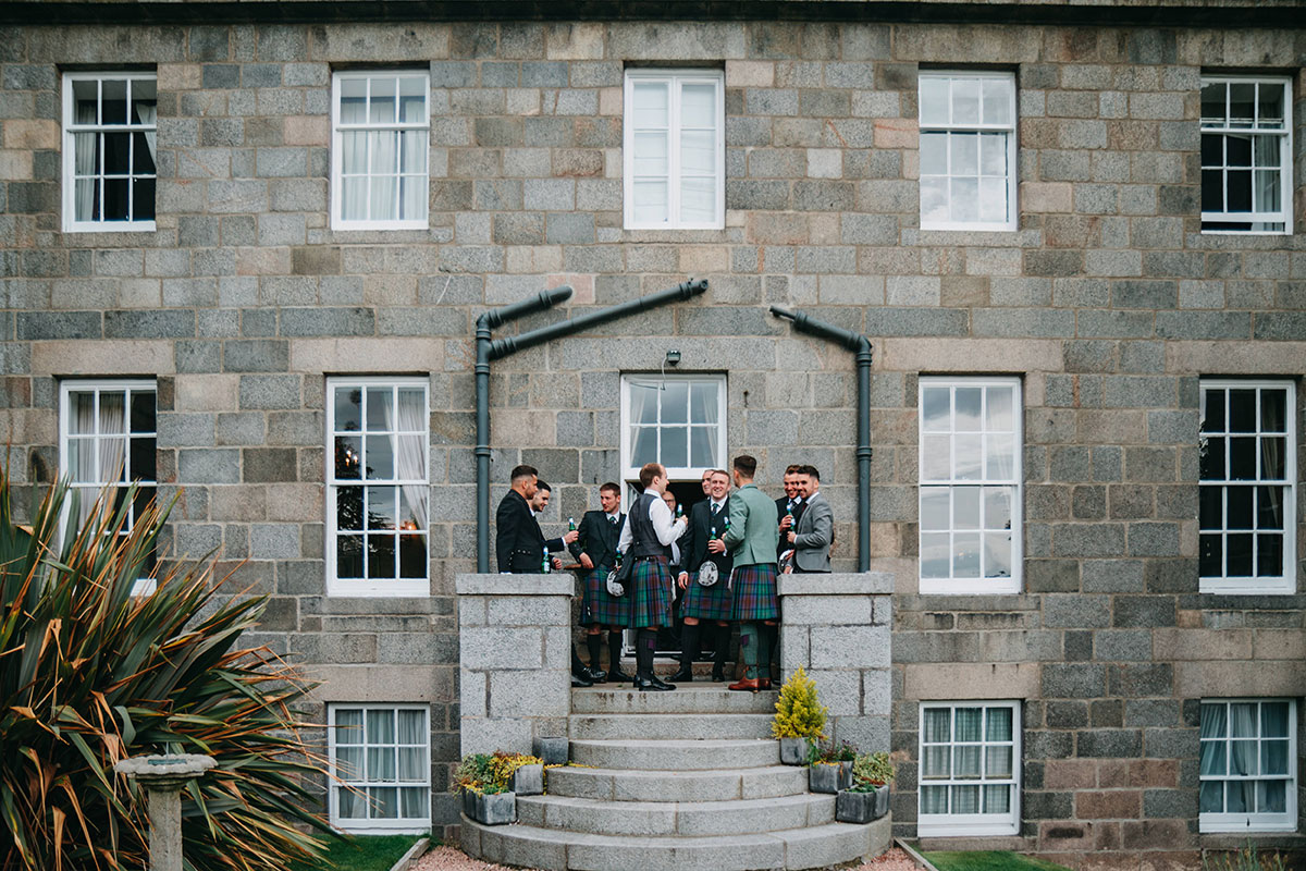 groom-and-groomsmen-on-terrace