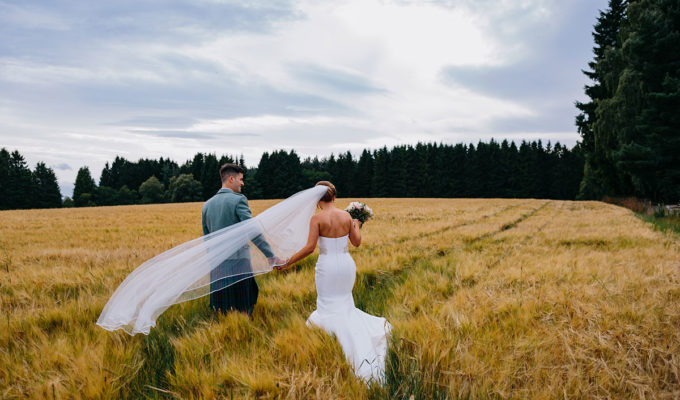 bride-and-groom-walking-in-field
