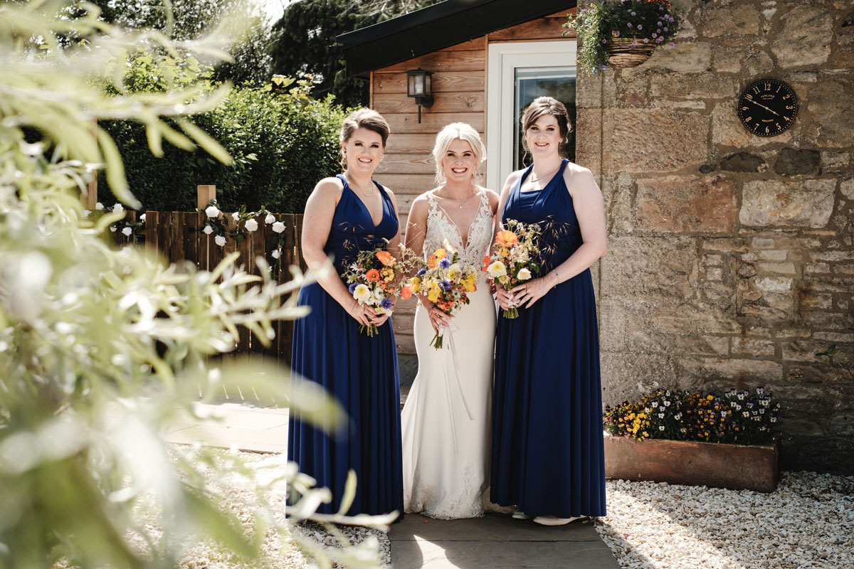 bride-and-bridesmaids-with-handpicked-bouquets